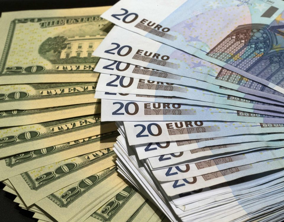 U.S. dollars and euros banknotes are seen in this illustration photo taken at a change bureau in Paris, October 28, 2014. The global economy will gradually improve over the next two years while the euro zone struggles with stagnation and an increased deflation risk, the OECD said on Tuesday November 25, 2014. The OECD has calculated that a gradual 10 percent depreciation of the euro and the yen against the dollar over the next two years could potentially raise growth in the euro area and Japan by around 0.2 percentage point next year and twice as much the following year. Picture taken October 28, 2014. REUTERS/Philippe Wojazer  (FRANCE - Tags: BUSINESS)